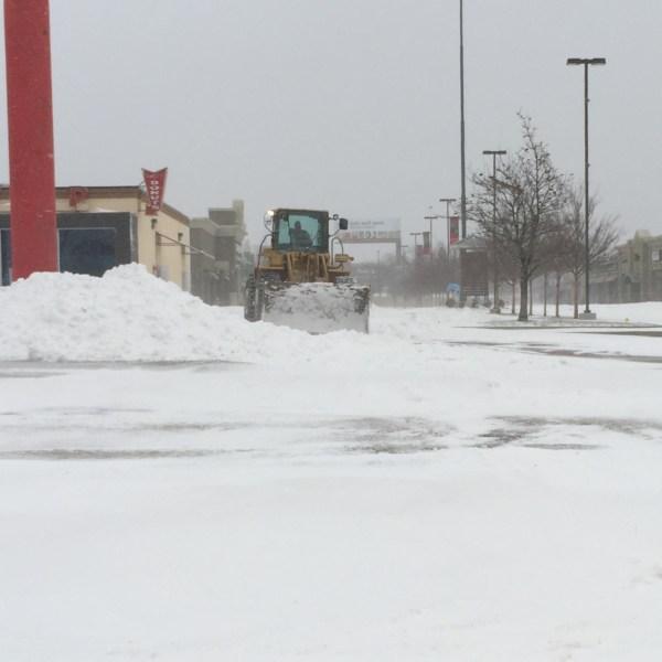 biz parking lot clean up blizzard 12-27-15_1451258939870.jpg
