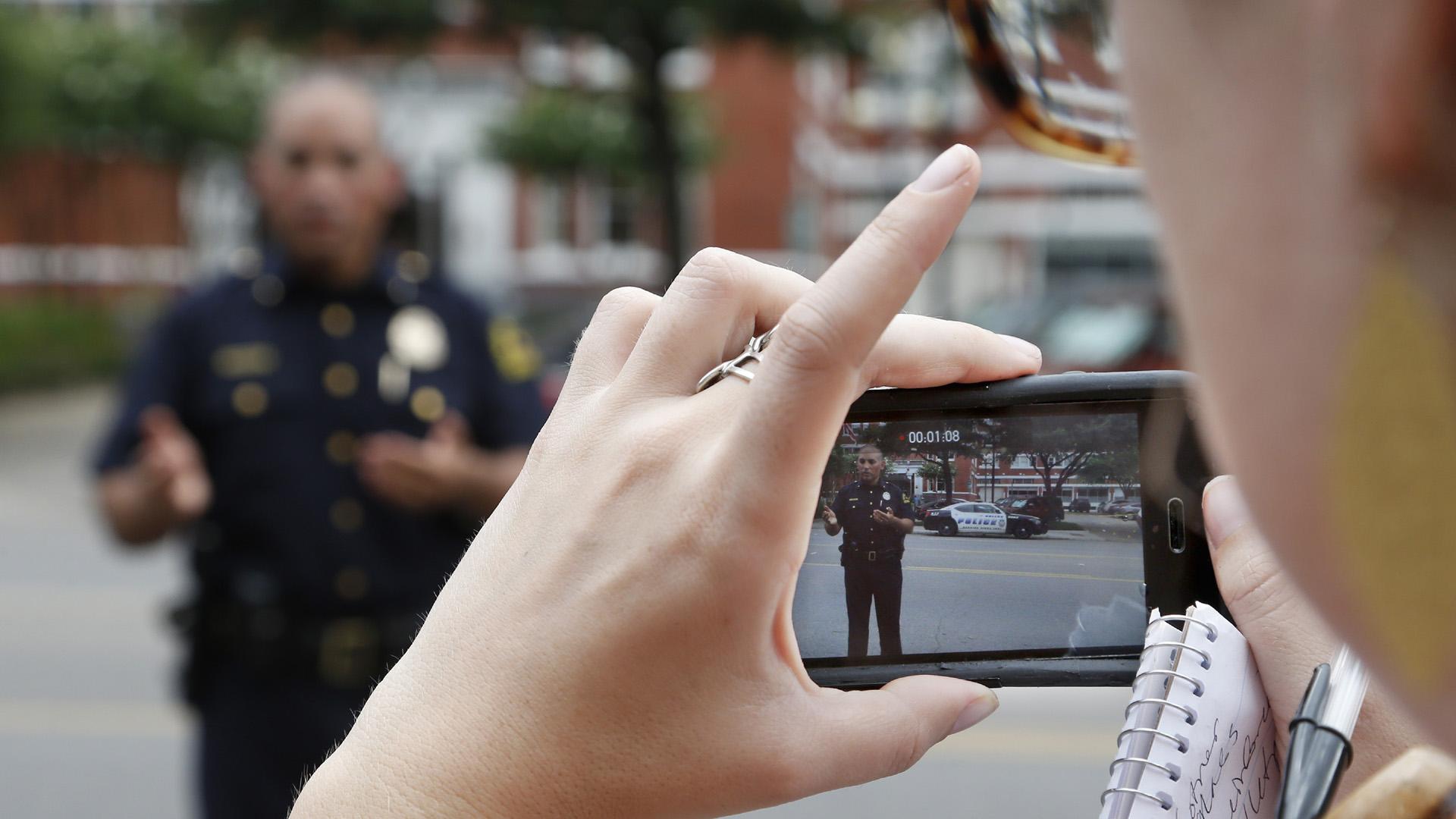 Phone reporter recording police26435246-159532