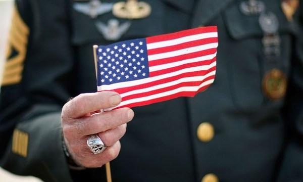 Veteran holding American flag, Veterans Day_3636146081216233-159532