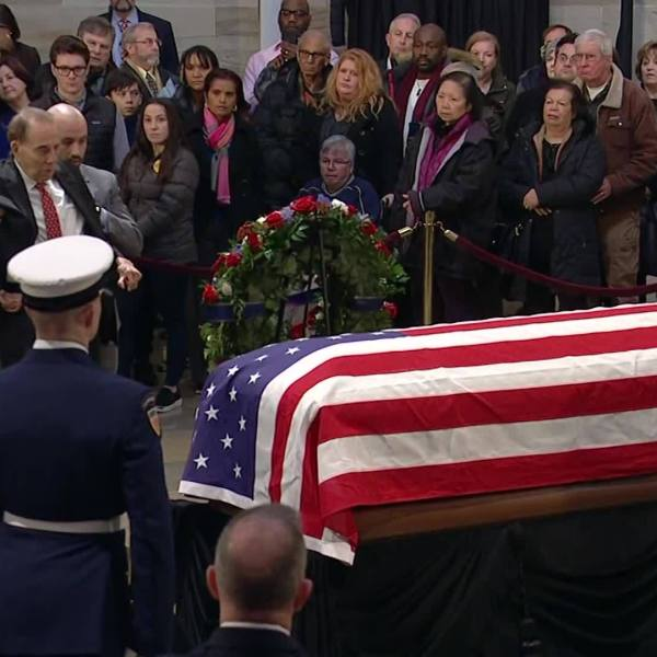 Bush 41: Bob Dole Stands To Salute Casket